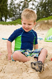 Little Boy Playing in Sand at the Beach Stock Images