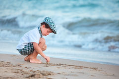 Little boy playing at sand beach Royalty Free Stock Photography