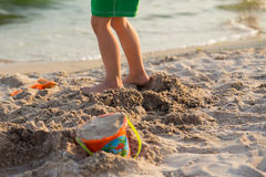 Little boy playing in the sand on the beach Royalty Free Stock Images