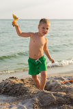Little boy playing in the sand on the beach Royalty Free Stock Photos