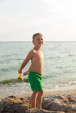Little boy playing in the sand on the beach Royalty Free Stock Photo