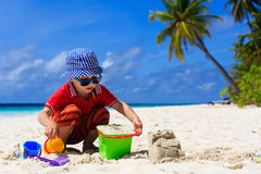Little boy playing with sand on the beach Royalty Free Stock Image