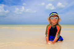 Little boy playing on sand beach Stock Image