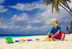 Little boy playing on sand beach Royalty Free Stock Photos