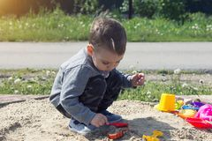 Little boy is playing in the sand royalty free stock photo