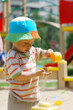 Little boy playing in sandbox Royalty Free Stock Images