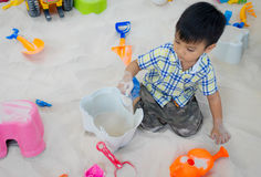 Little boy playing in a sandbox. Stock Photo
