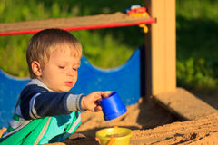 Little boy playing in sandbox Royalty Free Stock Image