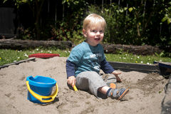 Little boy playing in a sandbox Royalty Free Stock Images