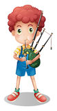 Little boy playing scottish bagpipe Stock Photo