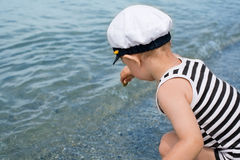 Little boy playing by the sea. Royalty Free Stock Photos
