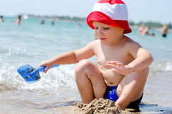 Little boy playing at the sea Stock Image