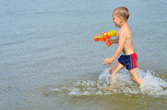 Little boy playing on the sea Stock Image