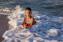 Little boy playing in sea surf Stock Photo