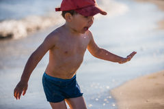 Little boy playing on the seashore Royalty Free Stock Photos