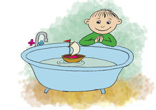 Little boy playing with ship in a bath Royalty Free Stock Images