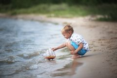 Little boy is playing with ship royalty free stock image