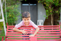 Little boy playing sitting Stock Photography