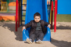 Little boy playing on slide Royalty Free Stock Photos