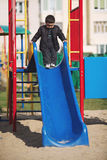 Little boy playing on slide Royalty Free Stock Photo