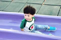 Little boy playing on a slider Stock Photography