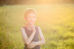 Little boy playing with slingshot Stock Images