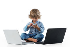 Little boy playing with smart phone royalty free stock image