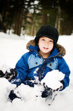 Little boy playing in the snow. Five year old boy outdoors in winter playing in the snow Stock Photos