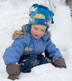 Little boy playing in the snow Stock Image
