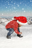 Little boy playing in the snow Royalty Free Stock Images