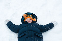 Little boy playing snow angels Royalty Free Stock Photography