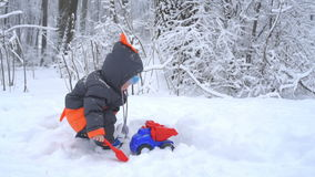 Little boy playing with snow stock video footage
