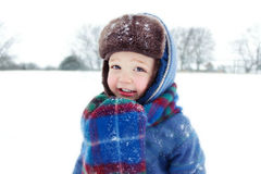 Little boy playing in snow Stock Image