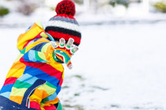 Little boy playing with snow in winter, outdoors. Stock Photo