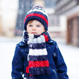 Little boy playing with snow in winter, outdoors. Stock Images