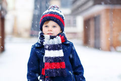 Little boy playing with snow in winter, outdoors. Stock Photography