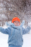 Little boy playing snowballs. Snowman sculpts; digs snow Royalty Free Stock Images