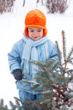 Little boy playing snowballs Royalty Free Stock Photo