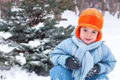 Little boy playing snowballs; Royalty Free Stock Photo