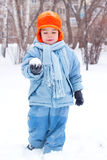 Little boy playing snowballs Stock Image