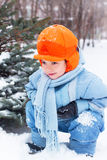 Little boy playing snowballs, snowman sculpts. Digs snow.  Holidays Christmas  and  New Year Stock Image