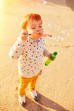 Little boy playing with soap bubbles Royalty Free Stock Photos