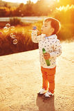 Little boy playing with soap bubbles Stock Photography