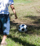 Little boy playing soccer Stock Images