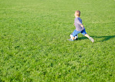 Little boy playing soccer Stock Photography