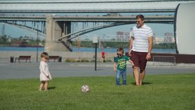 Family Playing Soccer in City Park stock video