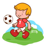 Little boy playing soccer Royalty Free Stock Photos