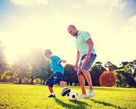 Little Boy Playing Soccer With His Father Stock Image