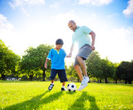 Little Boy Playing Soccer With His Father Royalty Free Stock Images