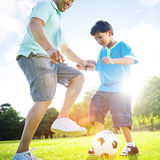 Little Boy Playing Soccer With His Father Concept.  Stock Images